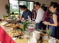 Wedding guests enjoying the food Buffet catering - Oh's Farm Catering from Oh's Farm Catering