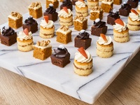Box of Mini Cakes - All Things Delicious Catering from All Things Delicious
