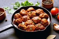 BIG Oozy Meatballs: chunks of cheddar cheese encased in well-seasoned tender minced chicken to produce tasty, moist and juicy, Big solid meatballs. Epitome of comfort food done right! from CHIPPY British Take Away