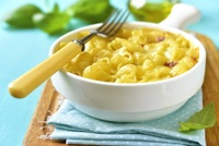 Macaroni and Cheese: blanched conchiglie pasta topped with creamy cheddar cheese sauce. from CHIPPY British Take Away