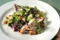 Kale Caesar salad with flaxseed crackers from Food Folk