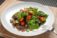 Roasted butternut squash on a bed of lentils dressed with a tahini sauce from Food Folk