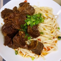 Hot Pepper Beef Brisket with Noodles from South and North Restaurant