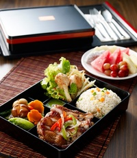 Premium Bento A:  Wok Tossed Fried Rice, Sauteed Baby Kailan with Mushroom, Sugarcane Prawn, Green Mango Salad, Char-Grilled Lemongrass Chicken and Fresh Fruit Plate. from The Orange Lantern Restaurant