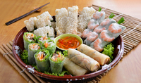 Assorted Vietnamese Roll Platter: a platter for the fans of hassle-free bites. Assorted rolls including signature rice paper rolls with prawn and chicken, imperial rolls, spring rolls & fish net rolls dipped in a special homemade sweet sauce and nuoc mam. from The Orange Lantern Restaurant