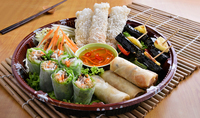 Saigon Platter: a perfect match of spring rolls, fresh rice paper rolls with chicken, imperial rolls, BBQ beef in betel nut leaves & mango salad. from The Orange Lantern Restaurant